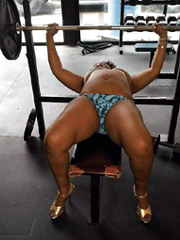 Elegant naked black mommy in the gym